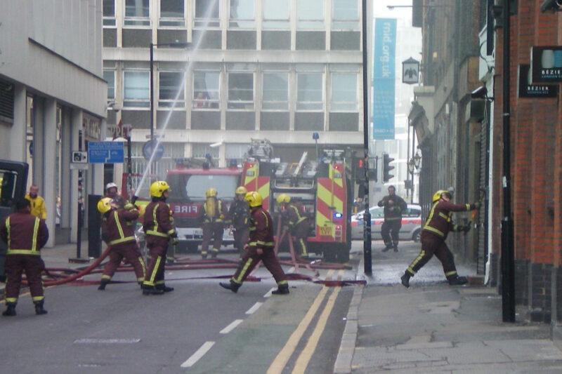 Fire fighters breaking down door