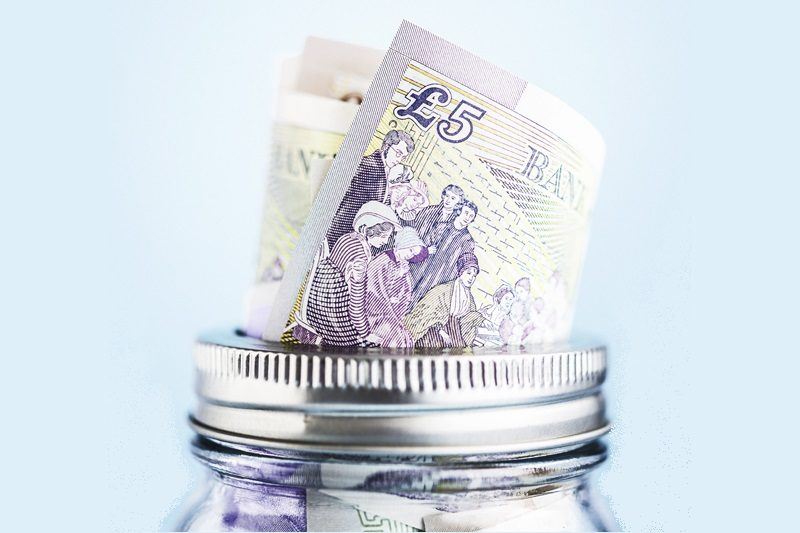 British currency in donation or savings jar