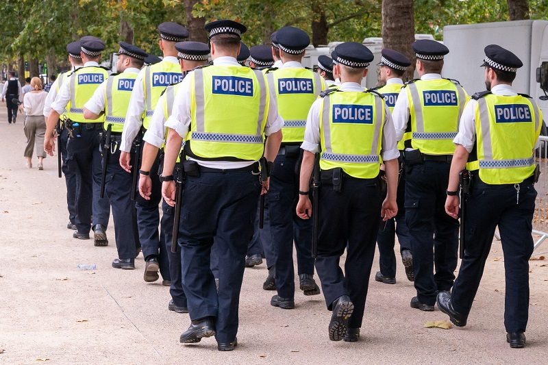 Group of Metropolitan Police officers policing in London.