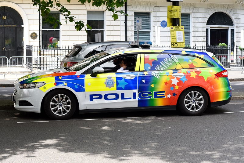 Police car in rainbow colours colors for Pride in London parade. LGBT+
